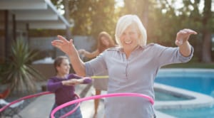 older woman with hula hoop
